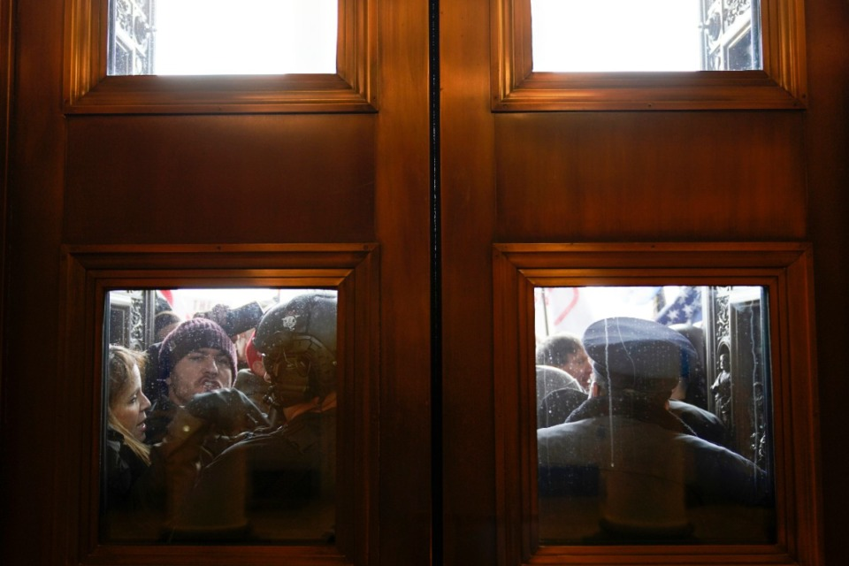 <strong>U.S. Capitol Police try to hold back protesters outside the east doors to the House side of the U.S. Capitol, Wednesday, Jan 6, 2021.</strong> (Andrew Harnik/AP)