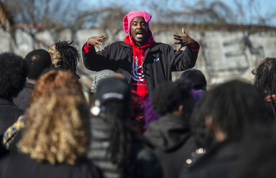 <strong>Memphis rapper AWFM directs fellow artists as they gather for a group photo ahead of the opening of The CLTV's new physical location, The CMPLX, in Orange Mound on Jan. 5, 2019, in Memphis.</strong> (Brandon Dill/Special To The Daily Memphian)