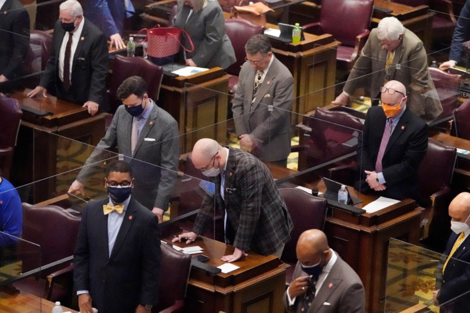 <strong>Members of the House of Representatives pause for a moment of silence for teachers who have died due to COVID-19 during a special session on education Thursday, Jan. 21, in Nashville.</strong> (Mark Humphrey/Associated Press)