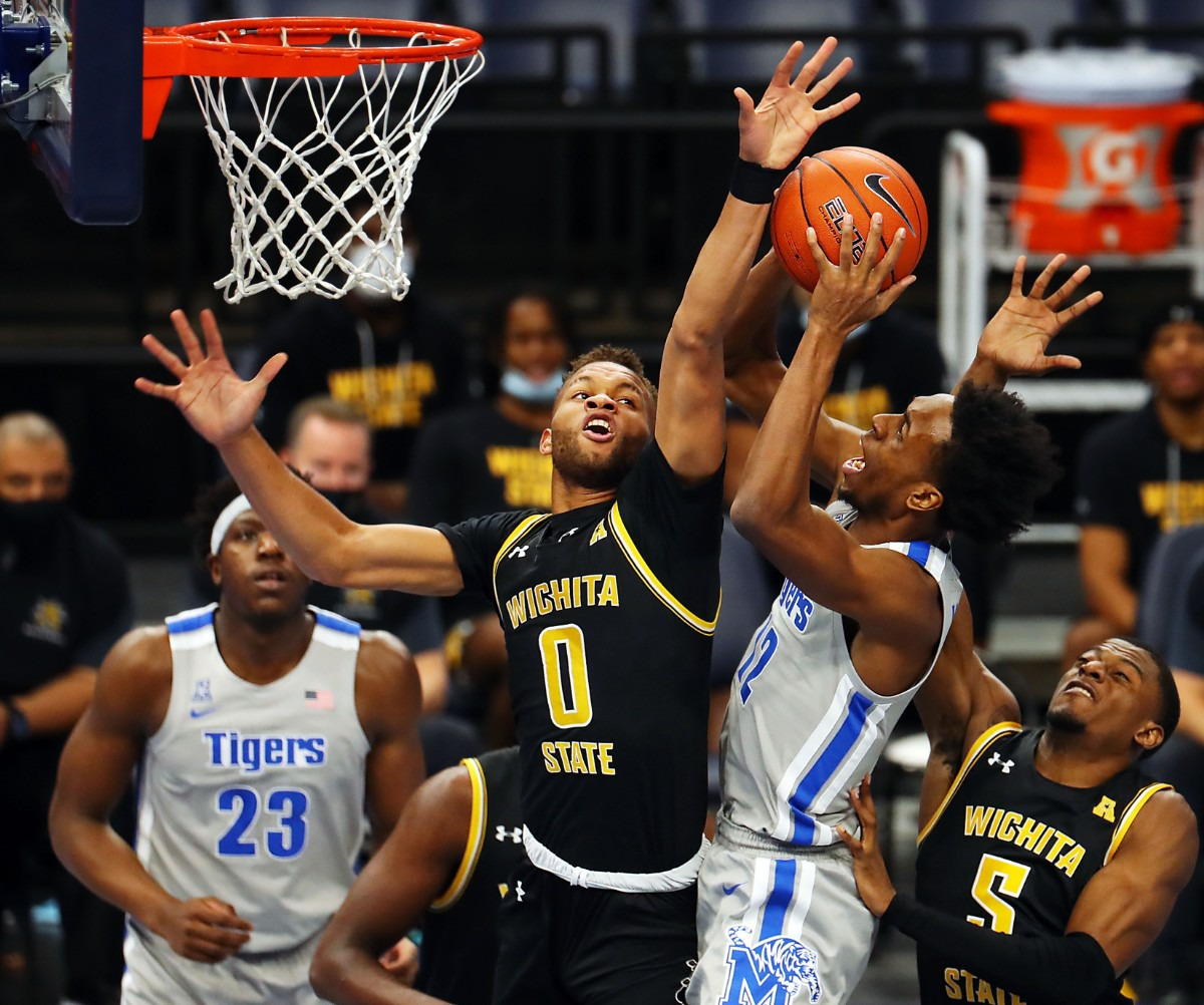 <strong>University of Memphis forward DeAndre Williams (12) goes up for a basket over Wichita State Shockers guard Dexter Dennis (0) on Jan. 21, 2021, at the FedExForum.</strong> (Patrick Lantrip/Daily Memphian)