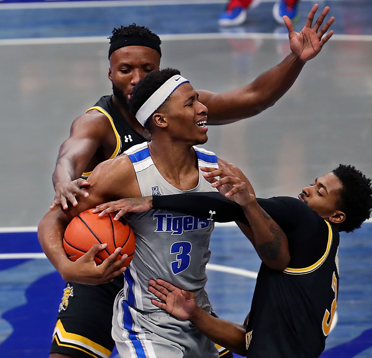 <strong>University of Memphis guard Landers Nolley II (3) is surrounded by a pair of Wichita State Shockers players on Jan. 21, 2021, at FedExForum.</strong> (Patrick Lantrip/Daily Memphian)
