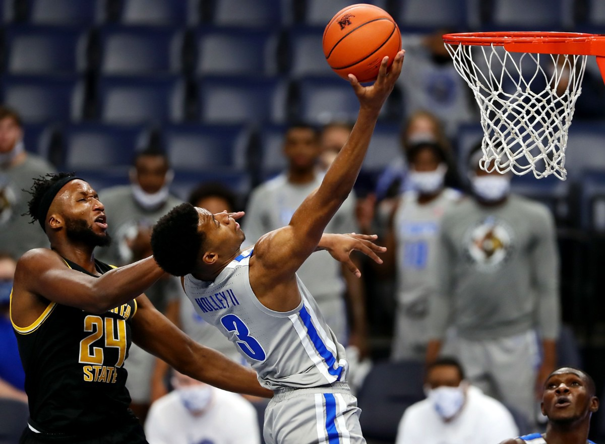 <strong>University of Memphis guard Landers Nolley (3) gets fouled by the Wichita State Shockers during a layup on Jan. 21, 2021, at FedExForum.</strong> (Patrick Lantrip/Daily Memphian)