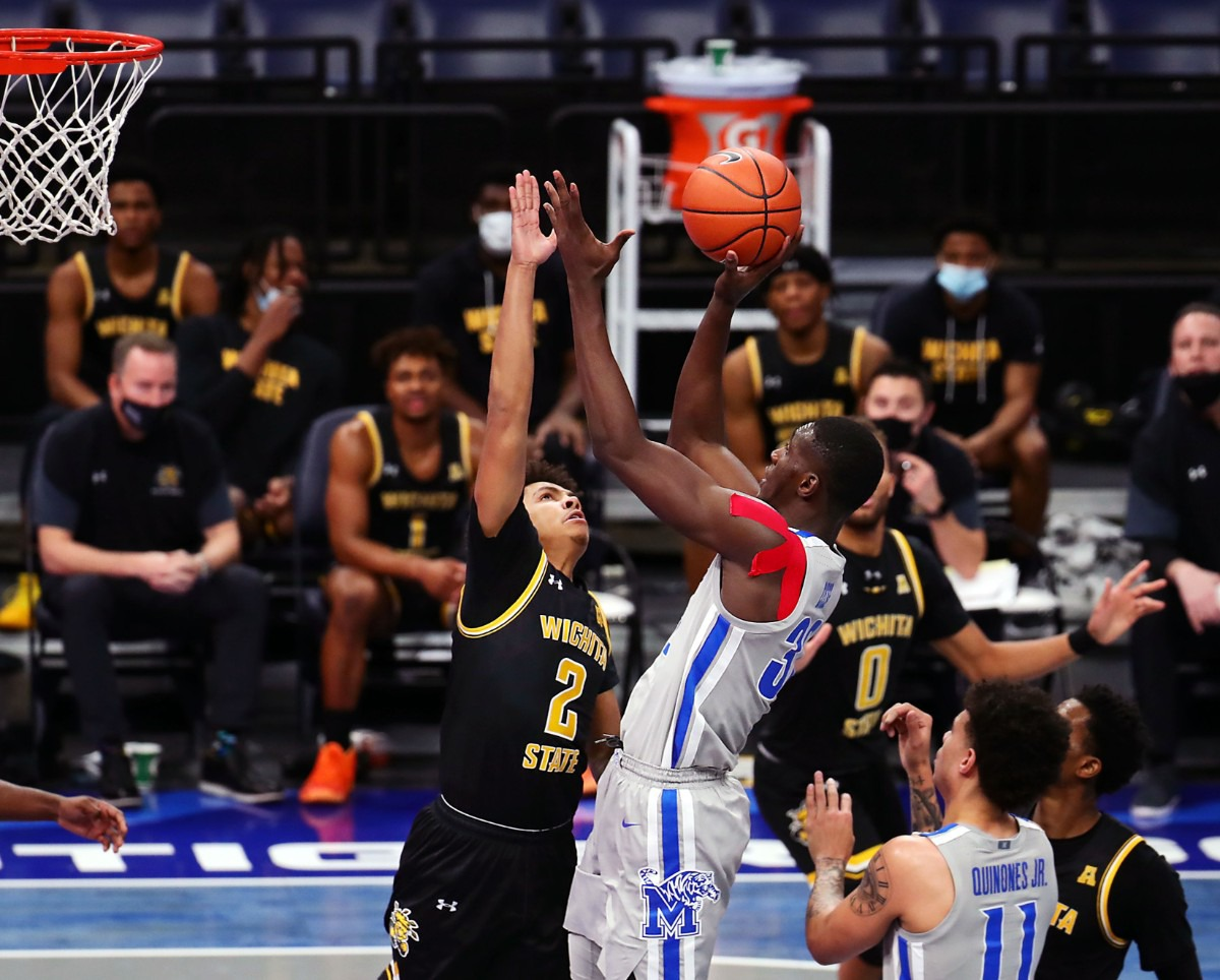 <strong>University of Memphis center Moussa Cisse (32) grabs a rebound during a Jan. 21, 2021, game against the Wichita State Shockers at FedExForum.</strong> (Patrick Lantrip/Daily Memphian)