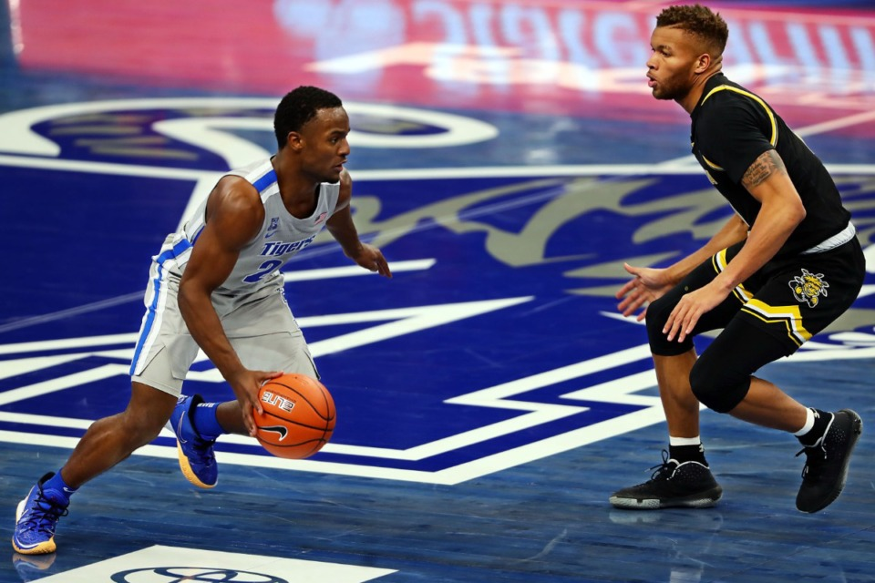 <strong>University of Memphis guard Alex Lomax (2) brings the ball upcourt during the Jan. 21 game against Wichita State.</strong> (Patrick Lantrip/Daily Memphian)