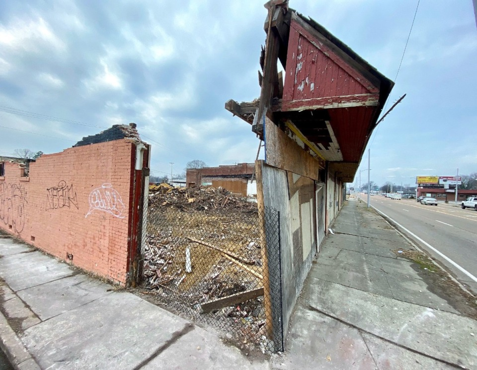 <strong>The dilapidated row of buildings at 3195 Summer Ave., the future site of Alliance Healthcare Services, had nearly been demolished by Friday, Jan. 22, 2021.</strong> (Tom Bailey/Daily Memphian)