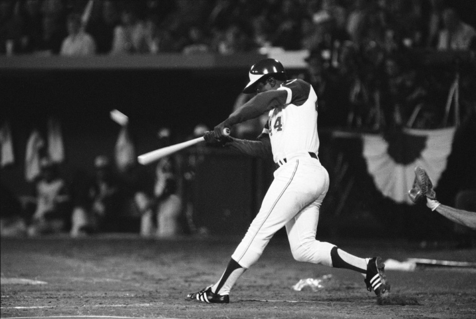<strong>Atlanta Braves slugger&nbsp;Hank Aaron hit his 715th career home run on April 8, 1974, in Atlanta Stadium, breaking the all-time record set by Babe Ruth. Aaron, who endured racist threats with stoic dignity during his pursuit of Ruth but went on to break the career home run record in the pre-steroids era, died Friday, Jan. 22. He was 86.</strong> (Joe Holloway Jr./Associated Press file)