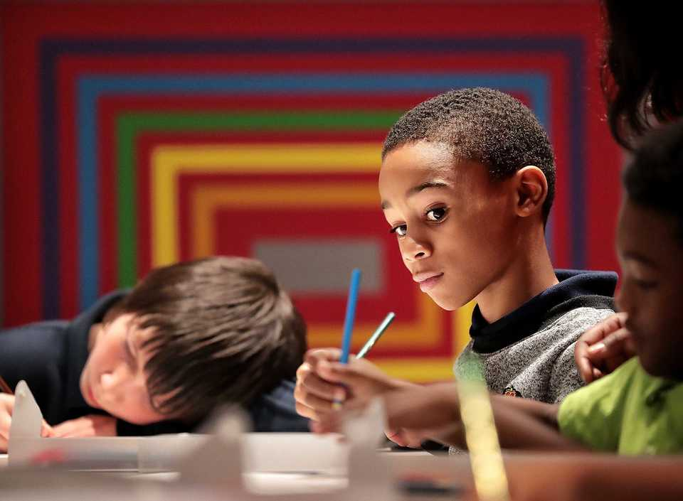 <strong>Shelby Oaks Elementary student Courtney Phillips works on a watercolor project during a visit by Brittany Rodgers' fourth grade class to the Brooks Museum of Art on September 9, 2018.</strong> (Jim Weber/Daily Memphian)