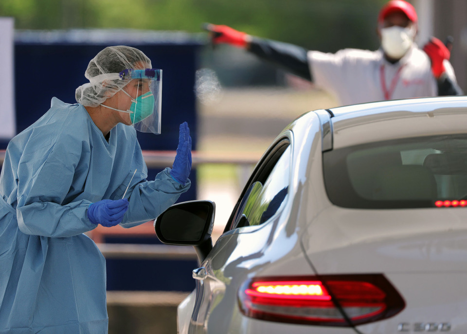 <strong>A doctor waves goodbye to a patient at Christ Community Health's drive-thru COVID-19 testing site in Whitehaven back in April.</strong> (Patrick Lantrip/Daily Memphian file)