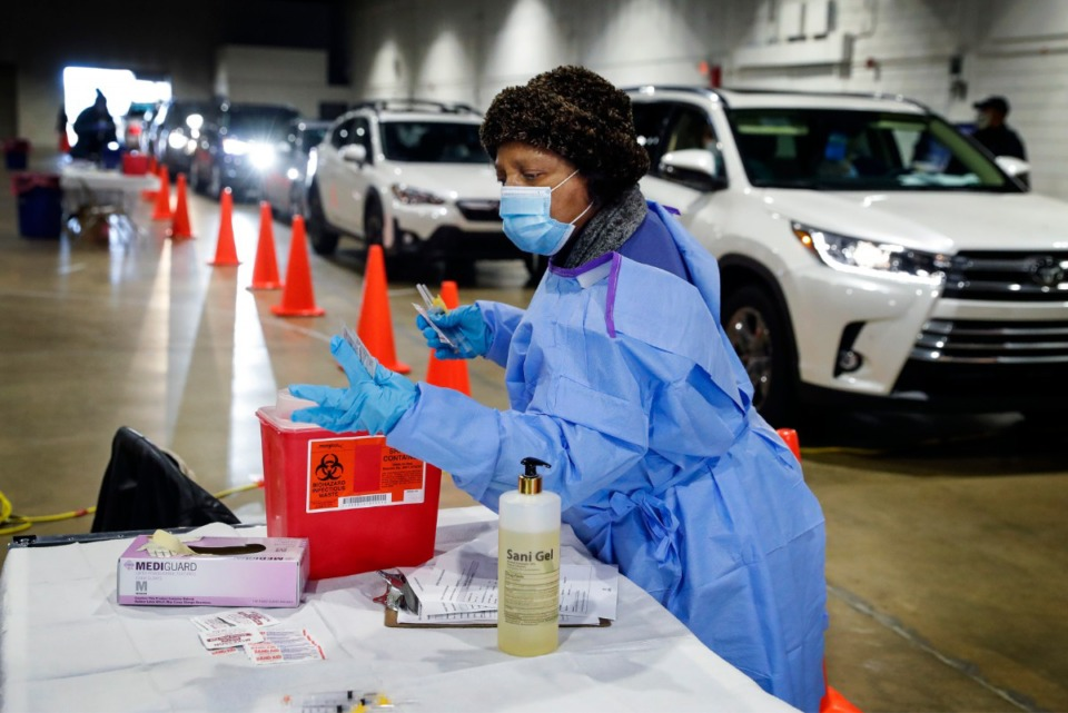 <strong>Shelby County Health Department personnel and volunteers administer COVID-19 vaccinations on Tuesday, Jan. 12, in the Pipkin Building at Tiger Lane.</strong> (Mark Weber/Daily Memphian)