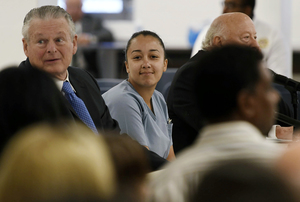 <span><strong>Cyntoia Brown, who is serving a life sentence for killing a man when she was a 16-year-old prostitute, talks with her attorney, Charles Bone (left), during her clemency hearing on May 23, 2018, at Tennessee Prison for Women in Nashville. On Monday, Jan. 7, 2019, Gov. Bill Haslam granted Brown clemency, commuting her sentence and enabling her to be released for parole supervision in mid-August after serving 15 years.</strong> (Lacy Atkins /AP Pool)</span>