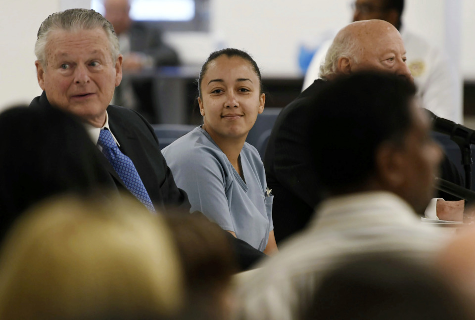 <span><strong>Cyntoia Brown, who is serving a life sentence for killing a man when she was a 16-year-old prostitute, talks with her attorney, Charles Bone (left), during her clemency hearing on May 23, 2018, at Tennessee Prison for Women in Nashville. On Monday, Jan. 7, 2019, Gov. Bill Haslam granted Brown clemency, commuting her sentence and enabling her to be released for parole supervision in mid-August after serving 15 years.</strong>&nbsp;(Lacy Atkins /AP Pool)</span>