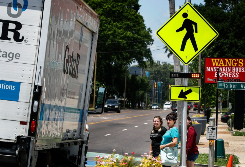 <strong>Pedestrians wait for traffic to stop before using the new Highland Strip crosswalk on June 26, 2019.</strong> (Mark Weber/Daily Memphian file)
