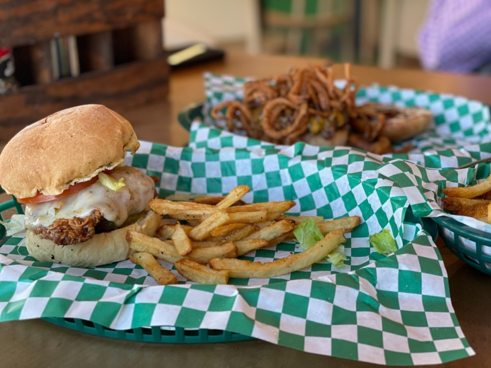 <strong>The Piper (in front) is a nice chicken sandwich, and the Cowboy is a burger hidden under a mound of onion strings in back.</strong> (Jennifer Biggs: Daily Memphian)