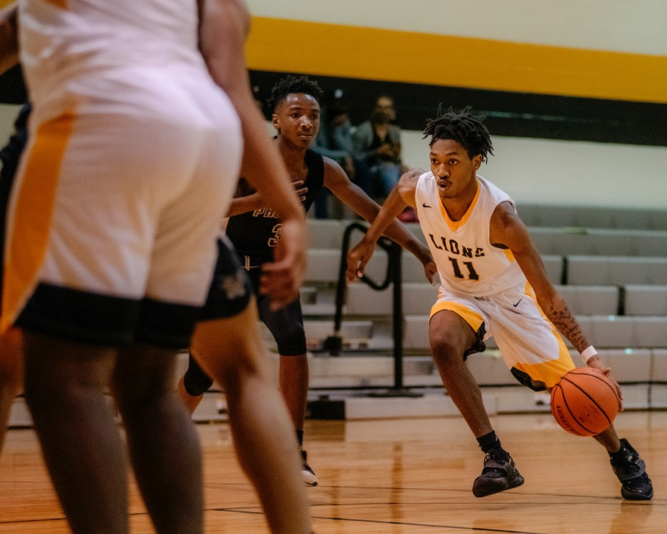 <strong>MAHS Lions guard Geoffry Shaw (11) drives to the basket against the MASE Phoenix on Jan. 26, 2021.</strong> (Houston Cofield / Special to The Daily Memphian)