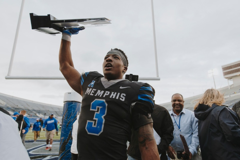 <strong>Anthony Miller raises the ACC West Title trophy in 2017.</strong> (Houston Cofield/Daily Memphian file)