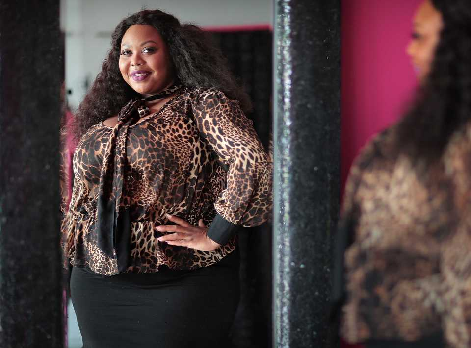 <strong>The host of two annual fashion events, The Weight Is Over Fashion Show and The Curvy Social, Ashley Dean-Parson, pictured at her Summer Ave. store on Sept. 9, 2018, has opened Dean of Fashion, Memphis' only independent plus-sized fashion boutique.</strong> (Jim Weber/Daily Memphian)