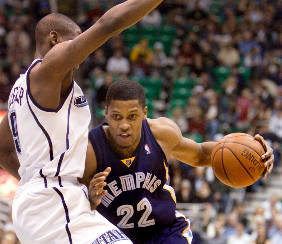 <strong>Former Memphis Grizzlies forward Rudy Gay (22) is stopped by Utah Jazz guard Ronnie Brewer (9) during the first quarter of the NBA basketball game Tuesday, Feb. 17, 2009, in Salt Lake City.</strong> (AP Photo/Douglas C. Pizac)