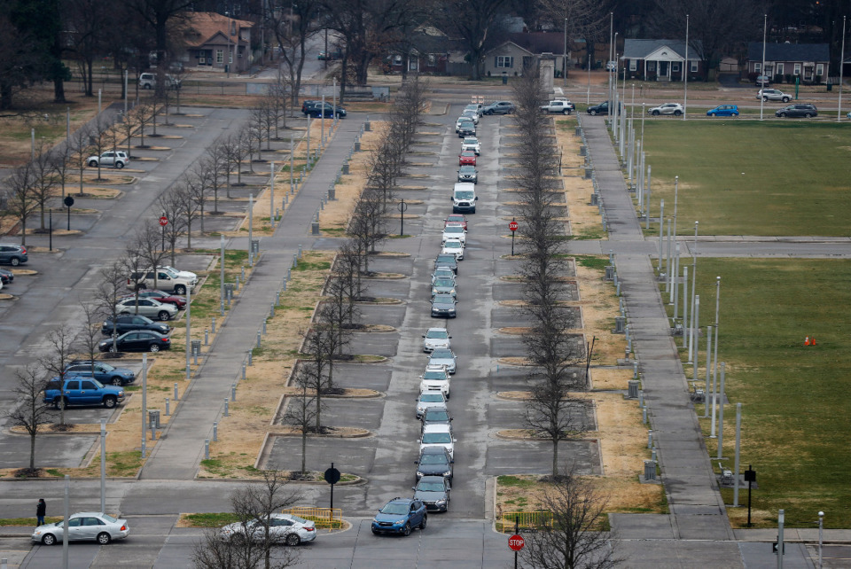 <strong>Cars snake their way though the parking lots at Tiger Lane on Wednesday, January 27, 2021 while waiting to receive the COVID-19 vaccine inside the Pipkin Building.</strong> (Mark Weber/The Daily Memphian)