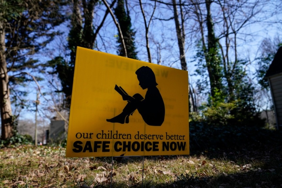 """<strong>A sign that reads """"our children deserve better safe choice now"""" is seen on Friday, Jan. 15, 2021, in Decatur, Georgia. Just down the road from the U.S. Centers for Disease Control and Prevention, in a community flush with resident health professionals, the Decatur school system had no shortage of expert input on whether to resume in-person classes amid the coronavirus pandemic. Scores of public health and medical professionals from the affluent, politically liberal Atlanta suburb have weighed in about what's best for their own kids&rsquo; schools.&nbsp;</strong>(Brynn Anderson/AP)"""