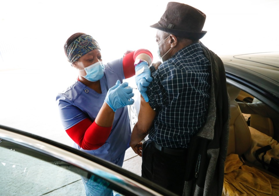 <strong>Memphis VA Medical Center personnel provide COVID-19 vaccinations to veterans on Tuesday, Jan. 26, 2021 in the hospital parking lot.</strong> (Mark Weber/The Daily Memphian file)