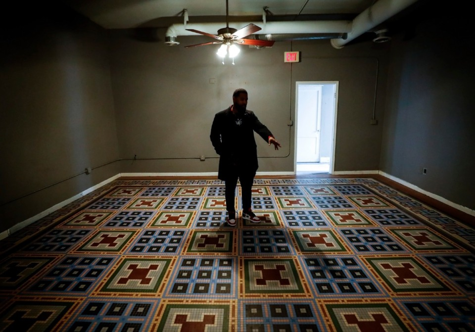 <strong>Ben Colar talks about the ornate tile floor inside his new cocktail bar, Inkwell, at 631 Madison on Thursday, Jan. 28. The building was once owned by a tile company</strong>. (Mark Weber/Daily Memphian)