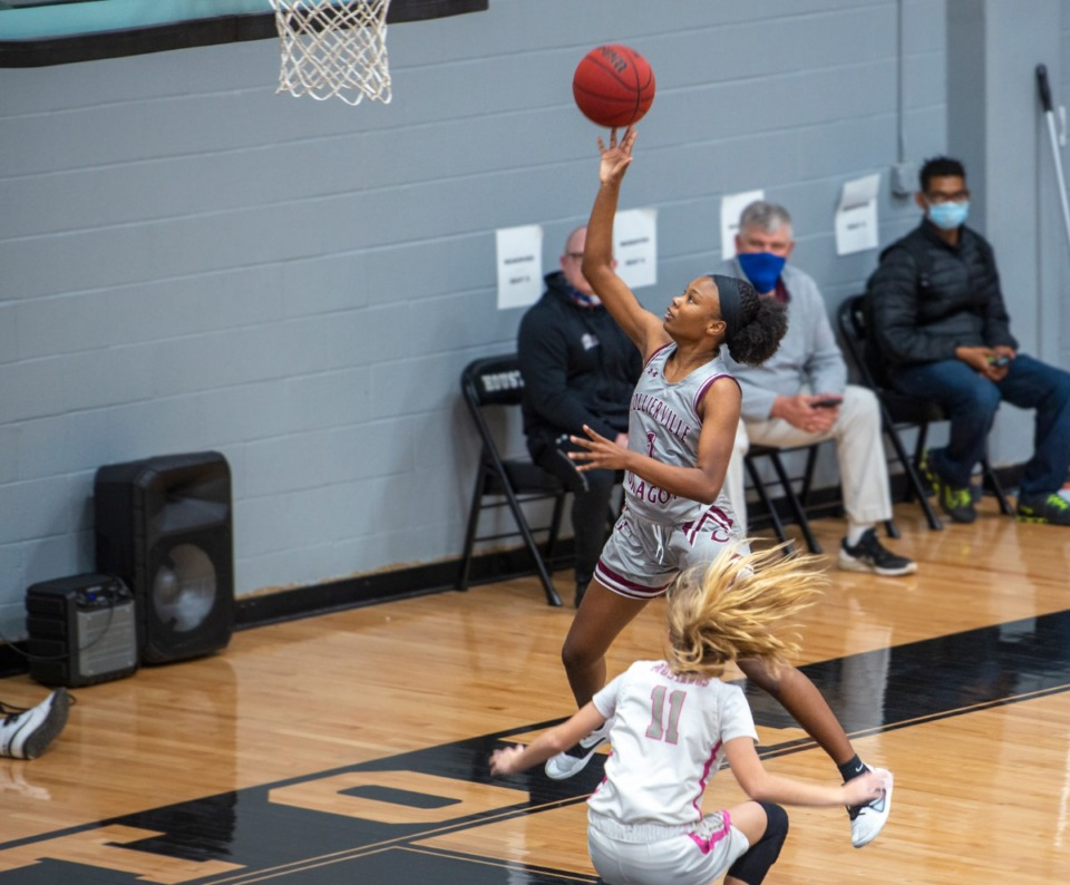<strong>Collierville High School's Mallory Taylor (1) goes up for a layup after a fast-break steal against Houston on Thursday, Jan. 21.</strong> (Greg Campbell/Special to the Daily Memphian)