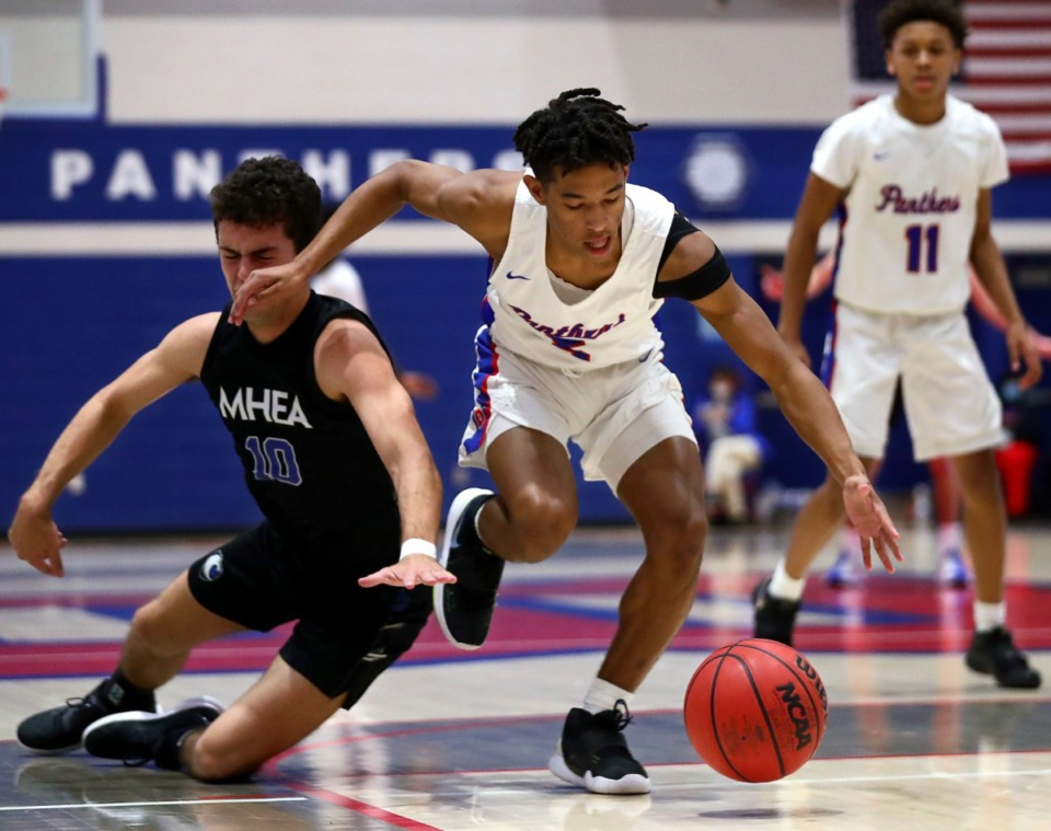 <strong>Bartlett guard Kamrin Jones (5) steals the ball during the Jan. 28 game against MHEA.</strong> (Patrick Lantrip/Daily Memphian)