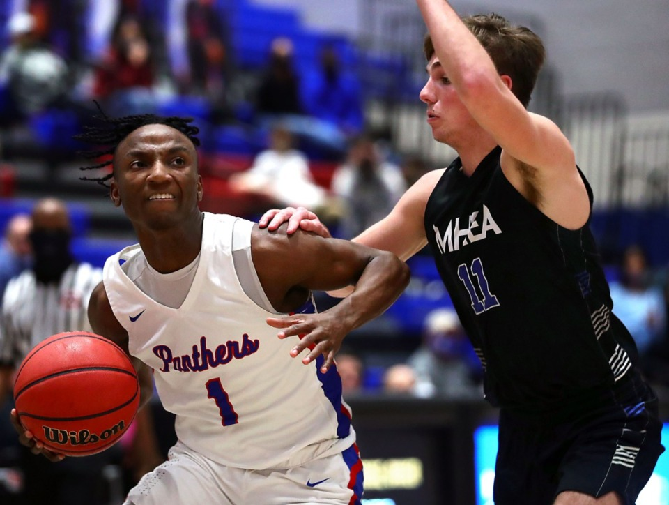 <strong>Bartlett guard Amarr Knox (1) drives to the basketl on Jan. 28 against MHEA.</strong> (Patrick Lantrip/Daily Memphian)