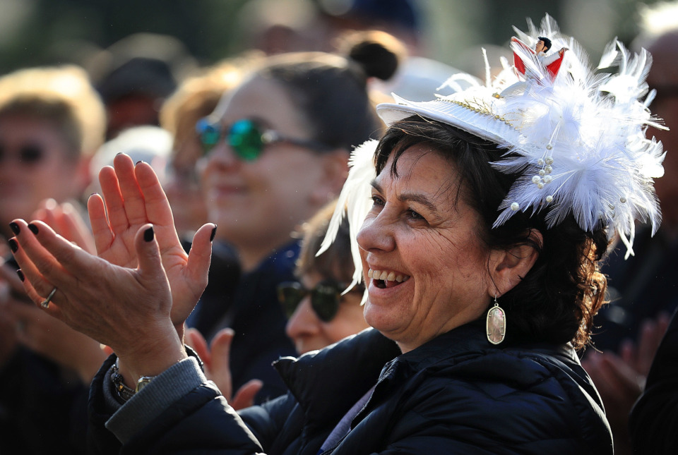 <strong>Michelle Mann from San Francisco, Calif., comes festooned with her Elvis hat as Elvis fans gather at Graceland on Jan. 8, 2019, to celebrate the King of Rock &rsquo;n' Roll's 84th birthday during the annual birthday proclamation and cake cutting ceremony on the front lawn.&nbsp;&nbsp;</strong>(Jim Weber/Daily Memphian)