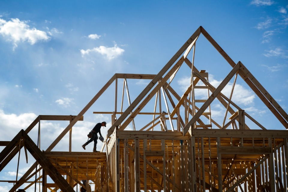 <strong>Workers frame a new home as construction continues at the Porter Farms residential development on Tuesday, Jan. 26, 2021 in Collierville.</strong> (Mark Weber/The Daily Memphian)