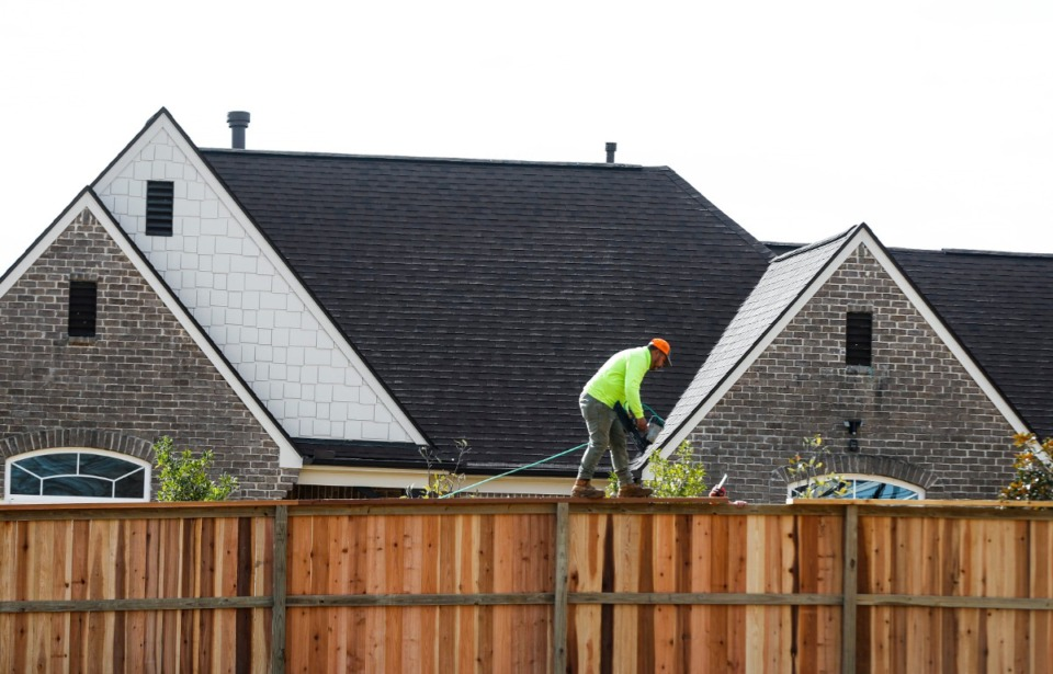 <strong>A worker builds a fence as construction continues at the Porter Farms residential development on Tuesday, Jan. 26, 2021 in Collierville.</strong> (Mark Weber/The Daily Memphian)