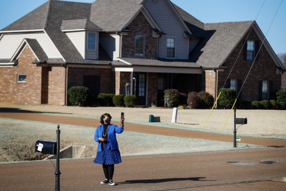 <strong>Cassandra Bell-Warren, the 2021 president of the Memphis Area Association of Realtors (MAAR), livestreams a showing of a Southaven home to a prospective buyer from out of town on Thursday, Jan. 28.</strong> (Mark Weber/Daily Memphian)