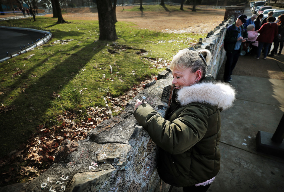 <strong>Debbie Davis from Bristol, England, signs the wall as Elvis fans gather at Graceland on Jan. 8, 2019, to celebrate the King of Rock &rsquo;n' Roll's 84th birthday during the annual birthday proclamation and cake cutting ceremony on the front lawn.&nbsp;</strong> (Jim Weber/Daily Memphian)
