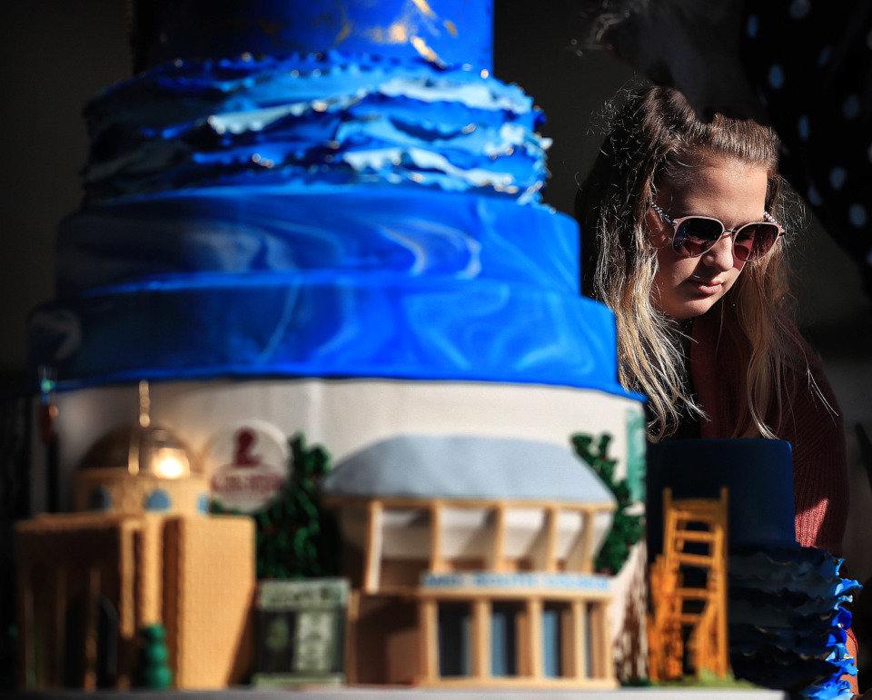 <strong>Sydney Laird with Cakes by Mom and Me helps dismantle and cut the birthday cake, which was built to represent 200 years of Memphis history, as Elvis fans gather at Graceland on Jan. 8, 2019, to celebrate the King of Rock &rsquo;n&rsquo; Roll&rsquo;s 84th birthday.</strong> (Jim Weber/Daily Memphian)