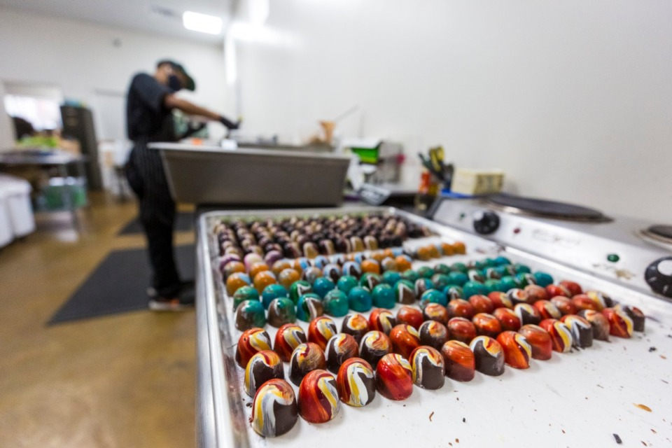 <strong>Martavious McGee prepares chocolates at Phillip Ashley Chocolates in Midtown on Monday, Feb. 1.</strong> (Ziggy Mack/Special to the Daily Memphian)