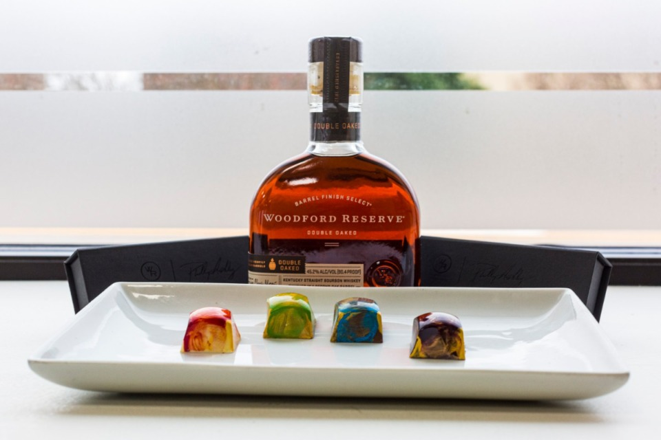 <strong>Phillip Rix&rsquo;s Phillip Ashley Chocolates partnered with Woodford Reserve Double Oaked bourbon when the company reached out to him to create chocolates to go with their double oaked.&nbsp;The four chocolates &mdash; one white, one blond, one milk chocolate and one dark &mdash; are each created to bring out a different element in the one whiskey, Rix said.</strong>&nbsp;(Ziggy Mack/Special to the Daily Memphian)