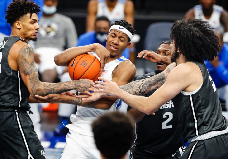 <strong>Guard Landers Nolley II (middle) fights for a rebound against UCF in the Tigers&rsquo; 96-69 win.&nbsp;Nolley led Memphis in scoring with 20 points.</strong>&nbsp;(Mark Weber/The Daily Memphian)