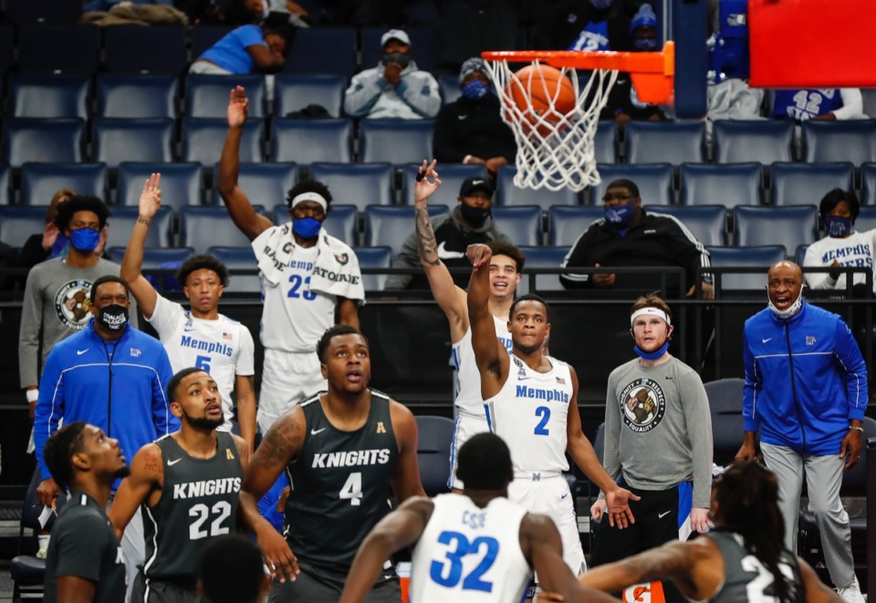 <strong>The Tigers bench celebrates a 3-point basket by teammate Alex Lomax (middle) in the 96-69 win over UCF Feb. 1.</strong> (Mark Weber/The Daily Memphian)