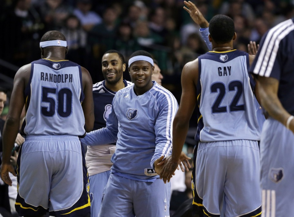 <strong>Teammates from the bench celebrate with Memphis Grizzlies power forward Zach Randolph (50) and small forward Rudy Gay (22) during a time out near the end of an NBA basketball game against the Boston Celtics in Boston, Wednesday, Jan. 2, 2013. The Grizzlies won 93-83.</strong> (AP Photo/Elise Amendola)