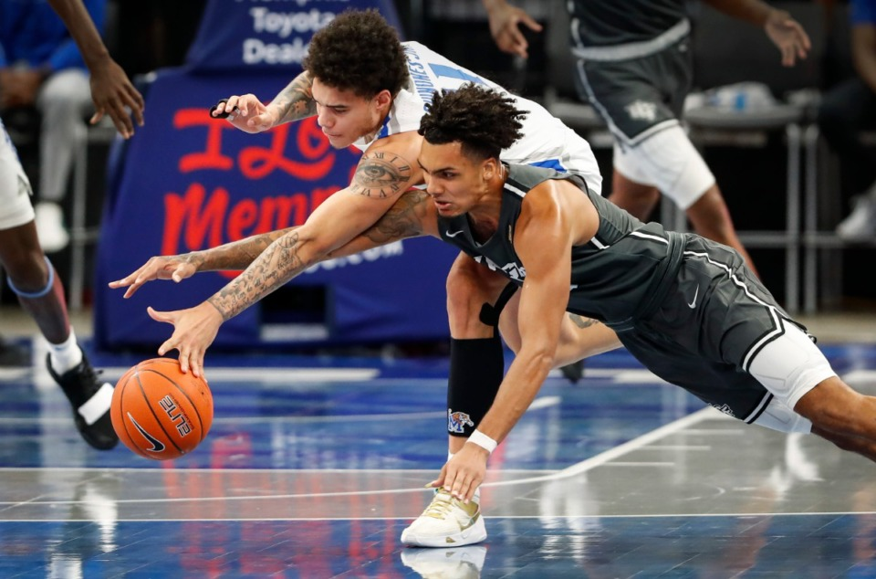<strong>Tigers defender Lester Quinones (top) battled UCF guard Brandon Mahan (bottom) for a loose ball earlier this week.</strong> (Mark Weber/The Daily Memphian)