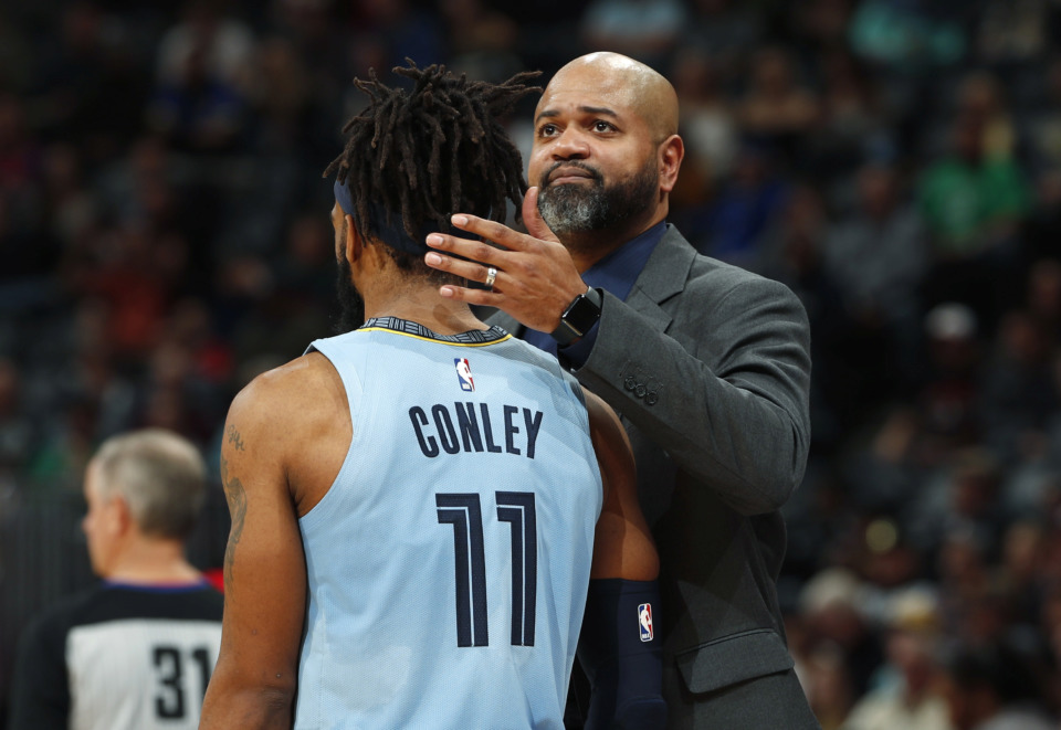 <span><strong>Memphis Grizzlies head coach J.B. Bickerstaff, back, consoles guard Mike Conley as the Denver Nuggets take the lead in the second half of an NBA basketball game Monday, Dec. 10, 2018, in Denver. The Nuggets won 105-99.</strong> (AP Photo/David Zalubowski)</span>