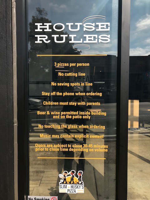 <strong>The house rules for Slim &amp; Husky's, 634 Union, are&nbsp;painted on the glass at the entrance.</strong> (Peggy Burch/Daily Memphian)