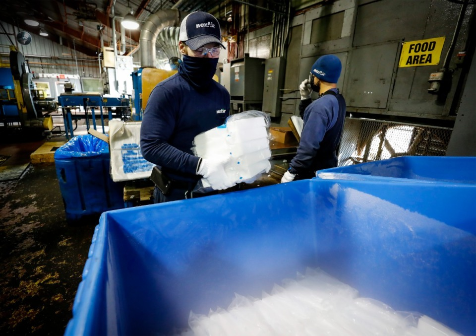 <strong>Josh Audirsch packages up blocks of dry ice at nexAir on Tuesday, Feb. 2, in Millington.</strong> <strong>The dry ice nexAir makes at its plants in Millington and Brandon, Mississippi, is in demand by companies that ship products, especially perishable foods.</strong> (Mark Weber/Daily Memphian)