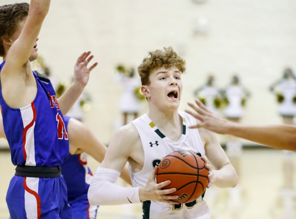 <strong>Briarcrest guard Cooper Haynes drives the lane against the MUS defense on Tuesday, Feb. 2, 2021.</strong> (Mark Weber/The Daily Memphian)