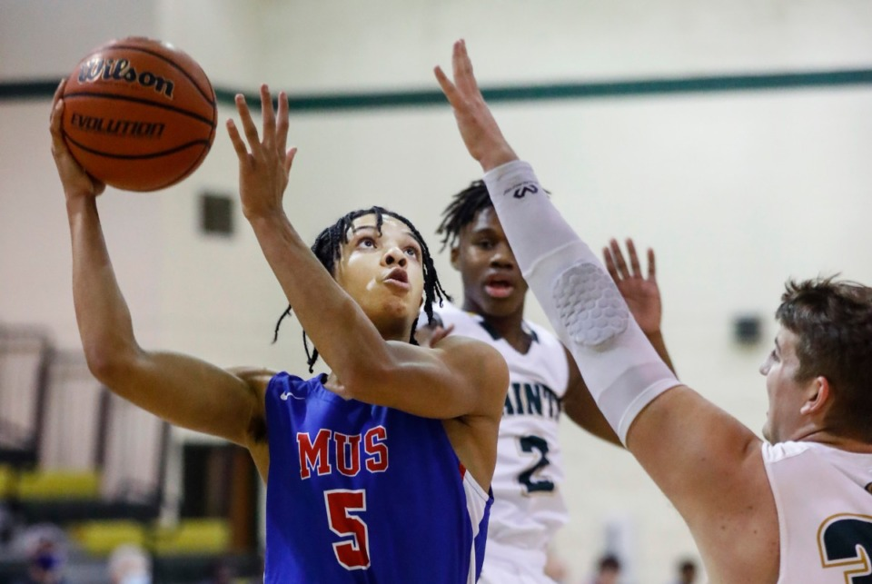 <strong>MUS guard Curtis Givens (left) drives to the basket against the Briarcrest defense Tuesday.</strong> (Mark Weber/The Daily Memphian)