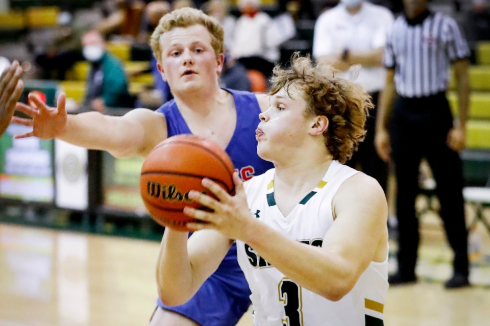 <strong>Briarcrest guard Tyler Harrington (front) drives the lane in front of MUS defender Jack Jabbour (back) on Tuesday, Feb. 2, 2021.</strong> (Mark Weber/The Daily Memphian)