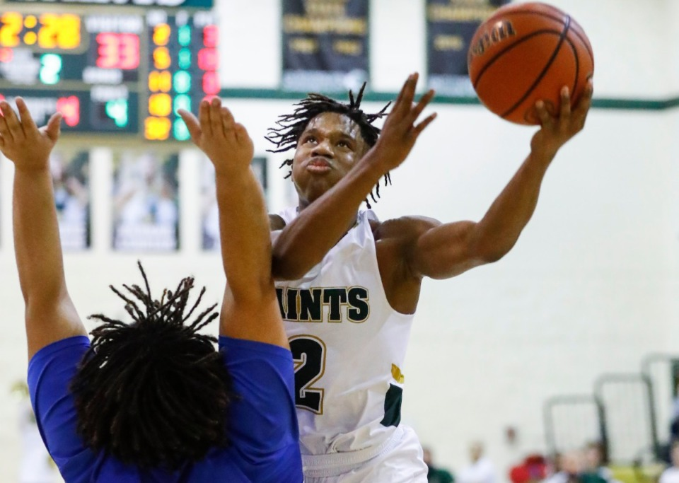 <strong>Briarcrest guard Jay Nash drives for a layup against MUS on Tuesday, Feb. 2, 2021.</strong> (Mark Weber/The Daily Memphian)