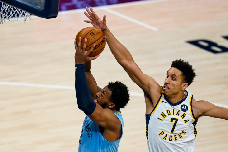 <strong>Memphis Grizzlies forward Xavier Tillman Sr. (2) shoots in front of Indiana Pacers guard Malcolm Brogdon (7) in Indianapolis on Tuesday, Feb. 2, 2021.</strong> (/Michael Conroy/AP)