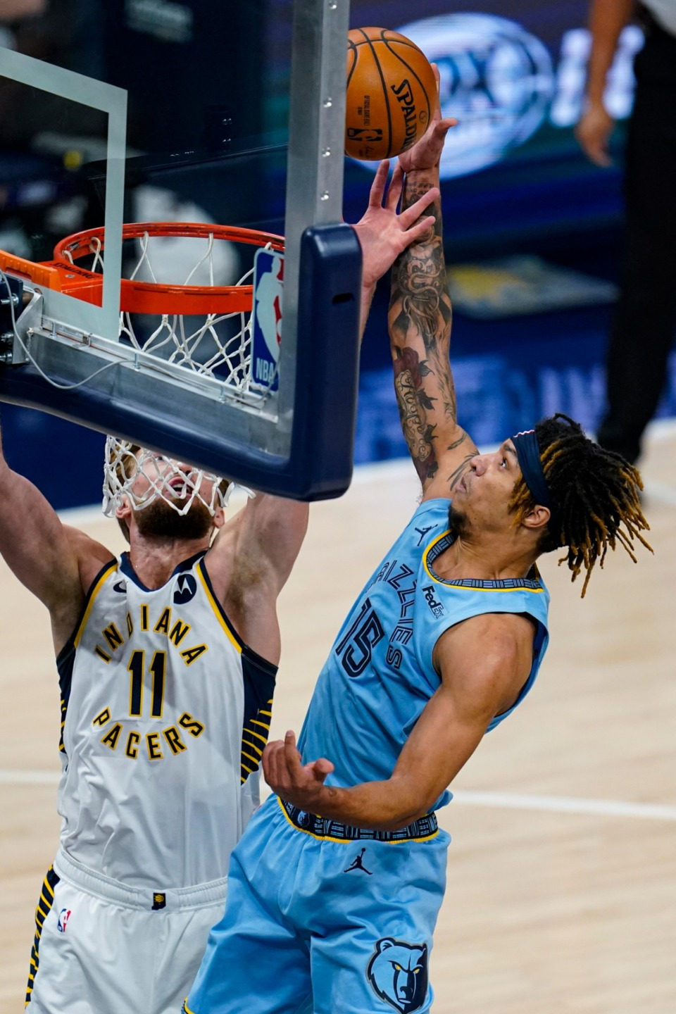 <strong>Memphis Grizzlies forward Brandon Clarke (15) gets a tip-in over Indiana Pacers forward Domantas Sabonis (11) in Indianapolis on Tuesday, Feb. 2, 2021.</strong> (Michael Conroy/AP)