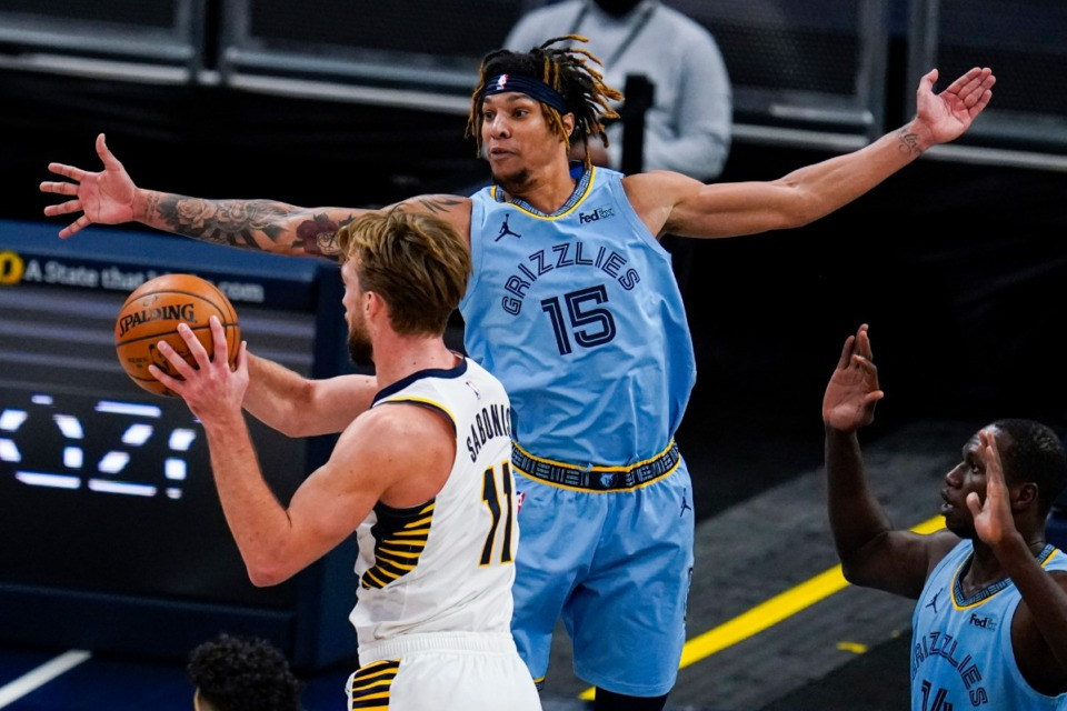 <strong>Memphis Grizzlies forward Brandon Clarke (15) defends against Indiana Pacers forward Domantas Sabonis (11) on Tuesday in Indianapolis.</strong> (Michael Conroy/AP)